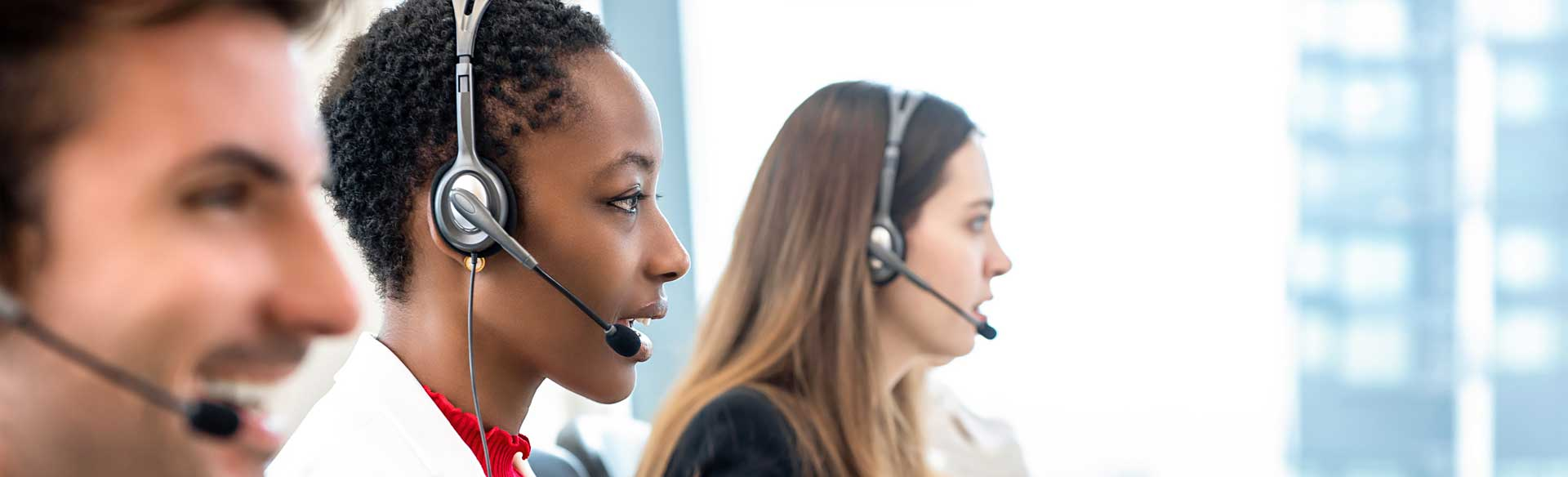 three_customer_service_reps_with_headsets